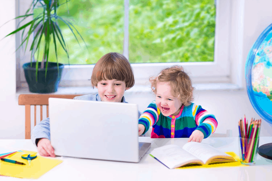 kids using a laptop for distance learning