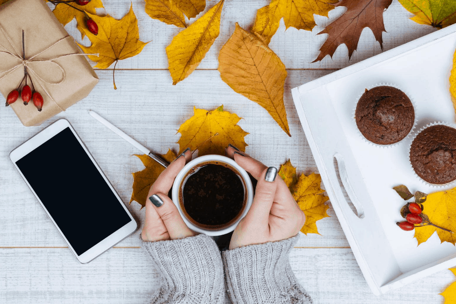 woman drinking coffee in fall