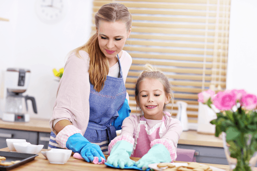mom and daughter organizing home